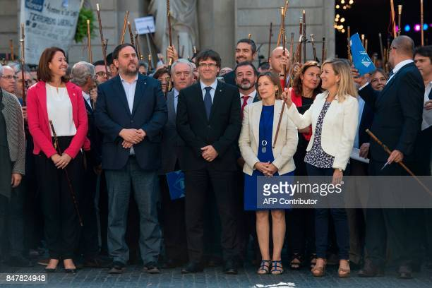 Catalan regional vicepresident and chief of Economy and Finance Oriol Junqueras President of the Catalan Government Carles Puigdemont and president...
