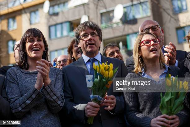Catalan separatist leader Carles Puigdemont Elsa Artardi and Aurora Madula pose for the media the day after his release from a German prison on April...