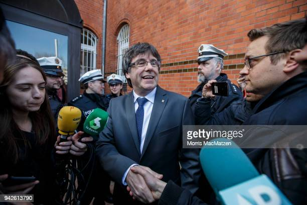 Catalan separatist leader Carles Puigdemont is guided back into the JVA after giving a statement for the assembled media just after he left the JVA...