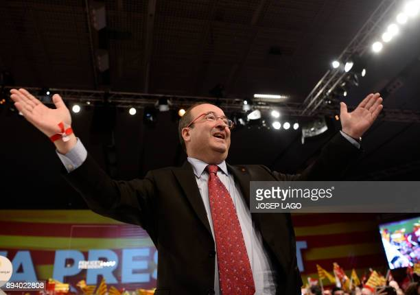 Catalan Socialist party candidate for the upcoming Catalan regional election Miquel Iceta waves during a campaign meeting in Barcelona on December 17...