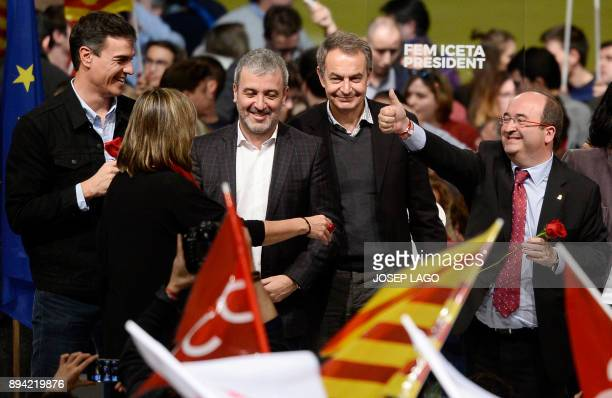 Catalan Socialist party candidate for the upcoming Catalan regional election Miquel Iceta thumbs up beside former Spanish Prime Minister Jose Luis...