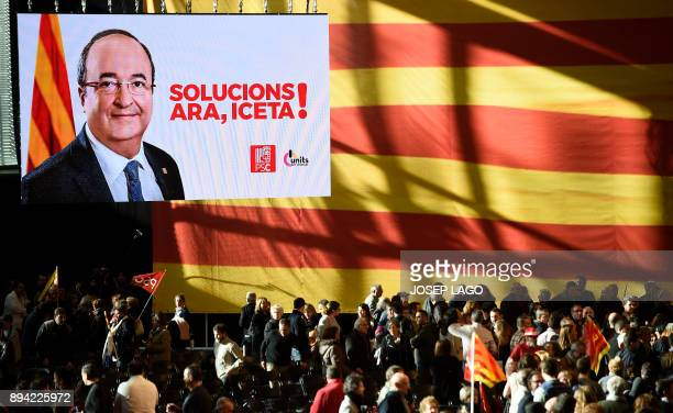 Catalan Socialist party candidate for the upcoming Catalan regional election Miquel Iceta appears on a screen during a campaign meeting for the...