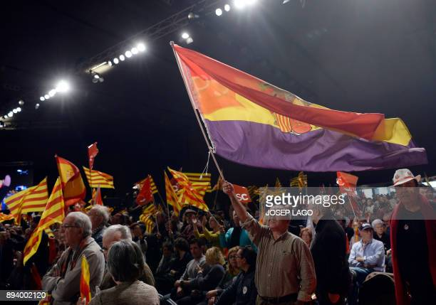 A Catalan Socialist party supporter waves a Republican flag during a campaign meeting for the upcoming Catalan regional election in Barcelona on...
