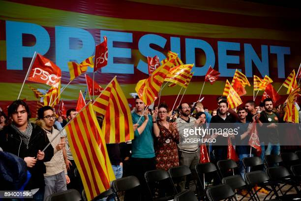 Catalan Socialist party supporters wave Catalan flags during a campaign meeting for the upcoming Catalan regional election in Barcelona on December...