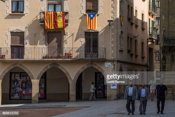 A Catalan Spanish and Catalan ProIndependence flags hang on a balcony on September 29 2017 in Vic Spain The Catalan goverment is keeping with its...