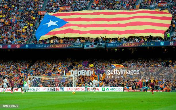 Catalan supporters display a giant Estelada during the Spanish league Clasico football match FC Barcelona vs Real Madrid CF at the Camp Nou stadium...