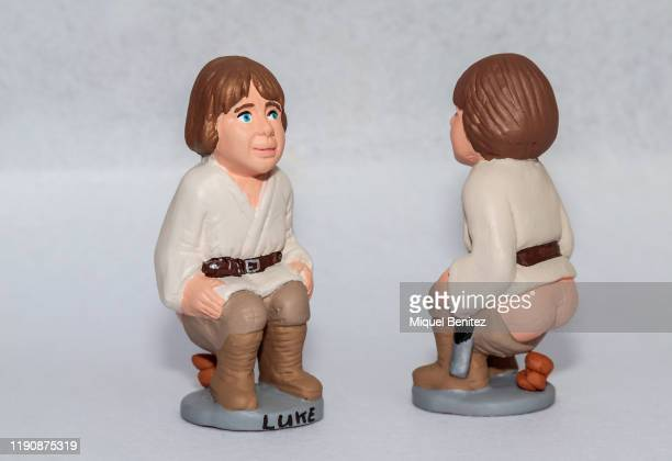"""Catalan typical ceramic figurines, called """"caganers"""" , depicting Luke Skywalker is displayed at Santa Llucia Christmas Fair in Barcelona on November..."""