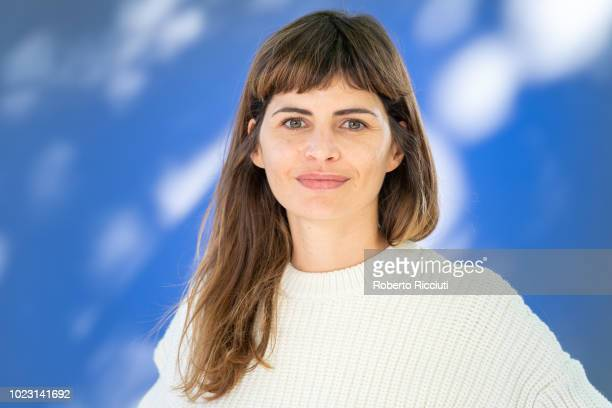 Catalan visual artist and writer Alicia Kopf attends a photocall during the annual Edinburgh International Book Festival at Charlotte Square Gardens...