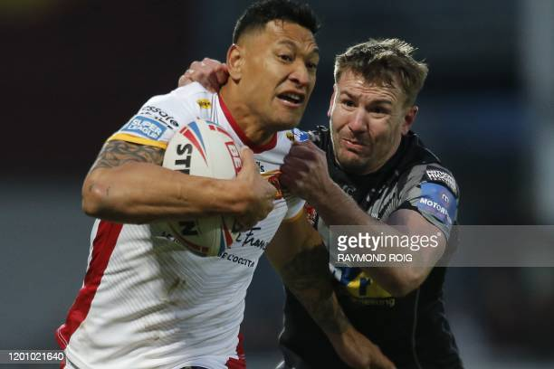 Catalans Dragons' Australian fullback Israel Folau powers his way during the Super League rugby match between Dragons Catalans and Castleford at the...