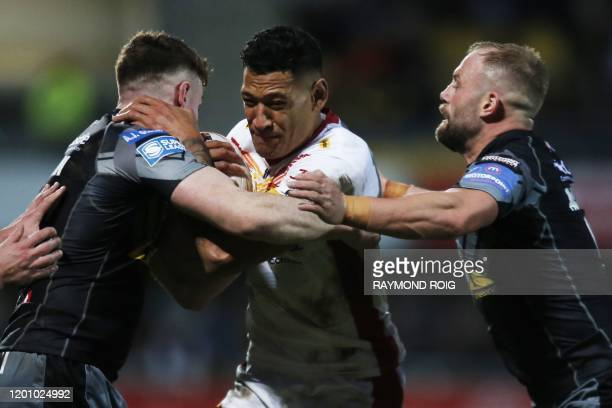 Catalans Dragons' Australian full-back Israel Folau powers his way during the Super League rugby match between Dragons Catalans and Castleford at the...