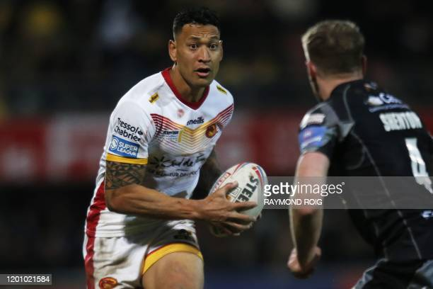 Catalans Dragons' Australian full-back Israel Folau runs with the ball during the Super League rugby match between Dragons Catalans and Castleford at...