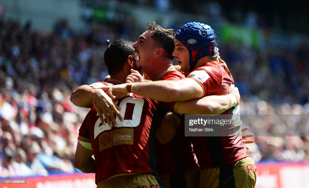 Catalans Dragons players celebrate as Lewis Tierney scores the opening try of the game during the Ladbrokes Challenge Cup Semi Final match between St Helens and Catalans Dragons at Macron Stadium on August 5, 2018 in Bolton, England.