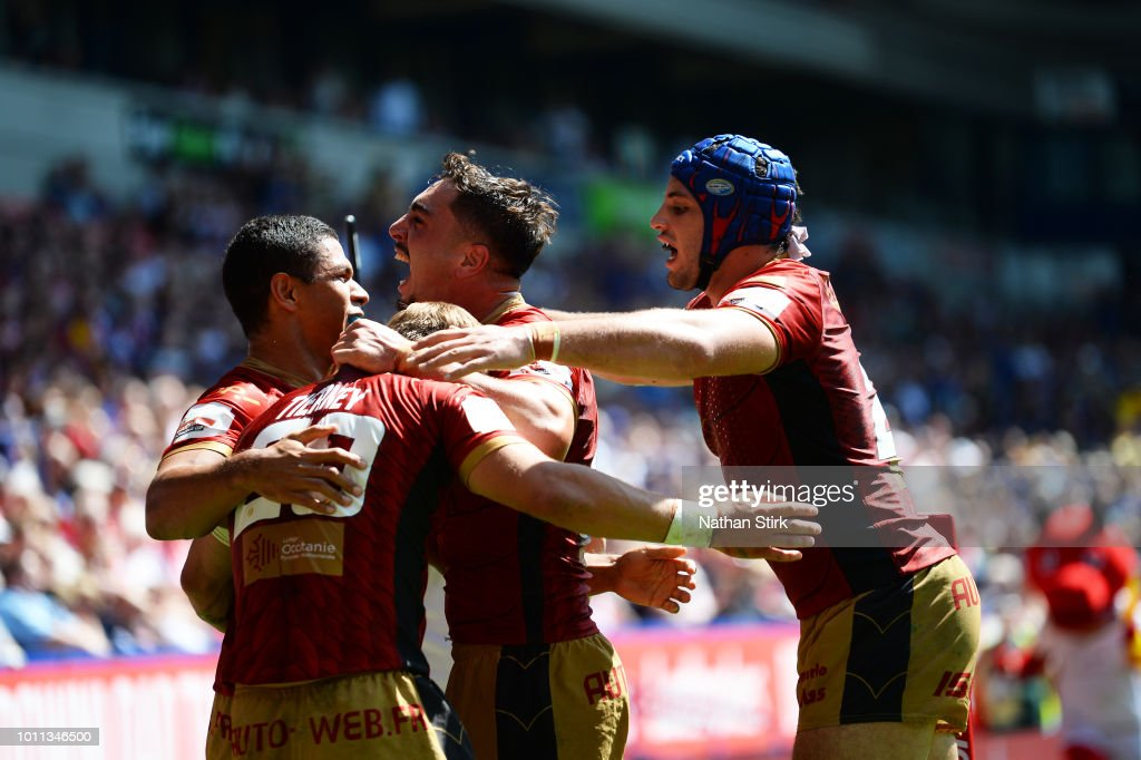 Catalans Dragons players celebrates as Lewis Tierney scores the opening try of the game during the Ladbrokes Challenge Cup Semi Final match between St Helens and Catalans Dragons at Macron Stadium on August 5, 2018 in Bolton, England.
