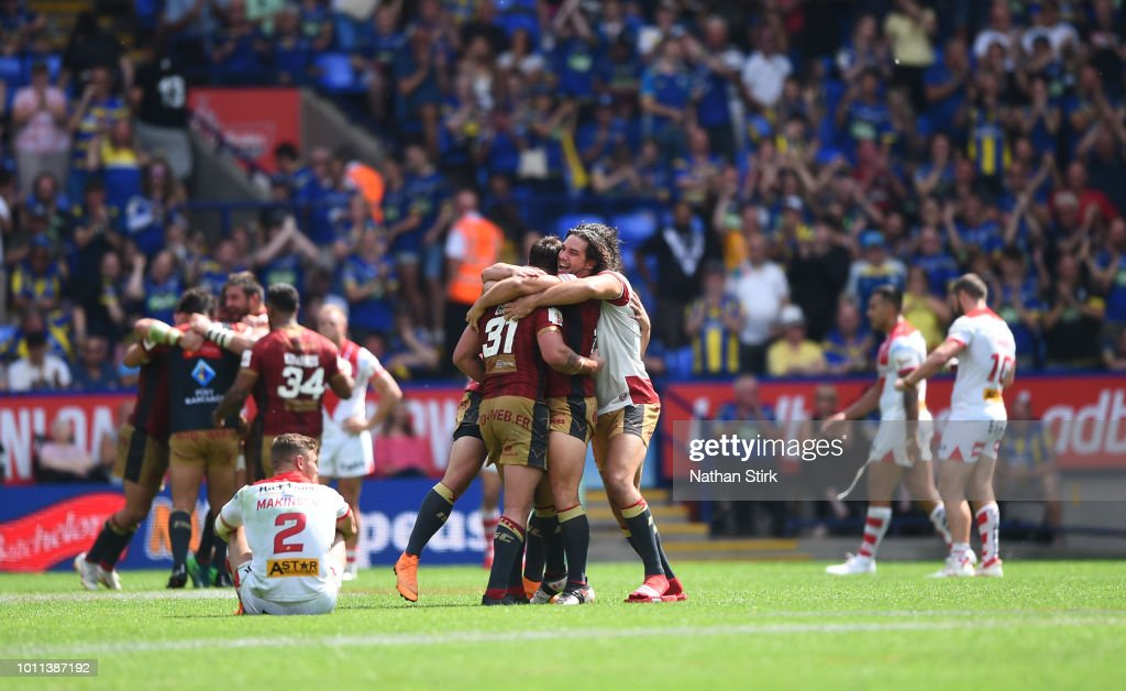 Catalans Dragons players celebrates as they beat St Helens during the Ladbrokes Challenge Cup Semi Final match between St Helens and Catalans Dragons at Macron Stadium on August 5, 2018 in Bolton, England.