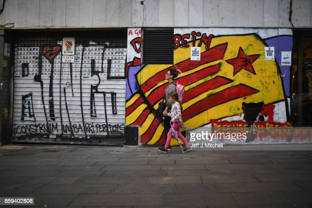 Catalans go about their daily business in the Vila de Gracia district ahead of tomorrow's parliamentary announcement on October 9 2017 in Barcelona...