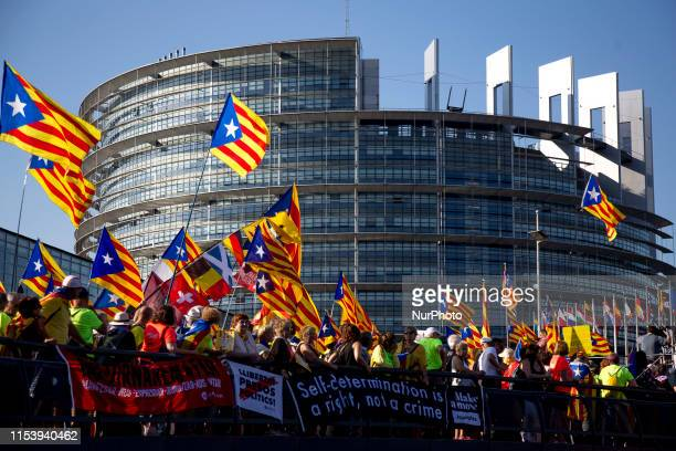 Catalans protest outside the European Parliament in Strasbourg Pro-independence activist supports MP Carles Puigdemont, Oriol Junqueras and Toni...
