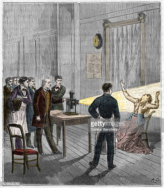 Catalepsy Jean Martin Charcot French neurologist and pathologist demonstrating production of hypnosis using beam of light from a magic lantern...