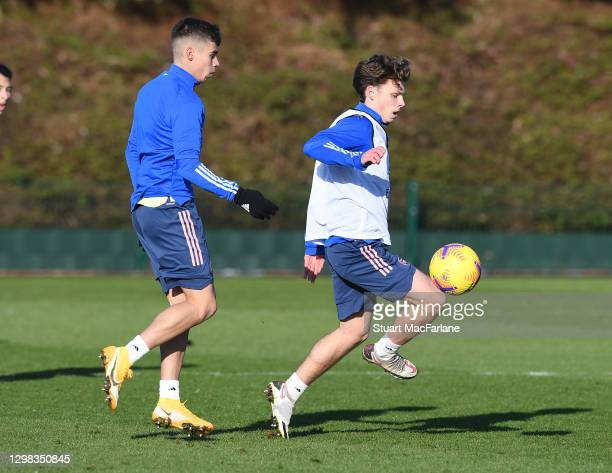 Catalin Cirjan and Ben Cottrell of Arsenal during a training session at London Colney on January 25, 2021 in St Albans, England.