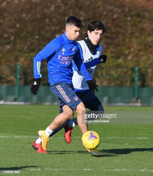 Catalin Cirjan and Hector Bellerin of Arsenal during a training session at London Colney on January 25, 2021 in St Albans, England.