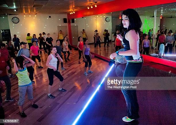 Catalina Mejia right certified by Guiness as the youngest Zumba instructor in the world in action during class on March 2012 in Gaithersburg MD