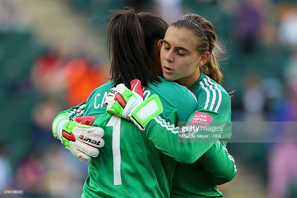 Catalina Perez #22 of Colombia hugs Stefany Castano #1 after receiving a red card during the FIFA Women's World Cup Canada 2015 Round of 16 match between the United States and Colombia at Commonwealth Stadium on June 22, 2015 in Edmonton, Canada.
