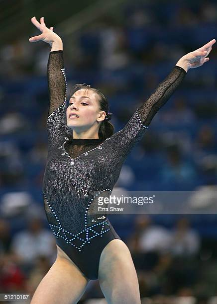 Catalina Ponor of Romania competes in the women's artistic gymnastics floor exercise finals on August 23 2004 during the Athens 2004 Summer Olympic...