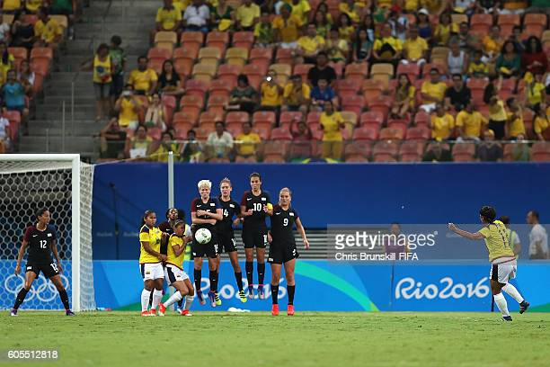 Catalina Usme of Colombia scores the first goal during the Rio 2016 Olympic Women's Football match between Colombia and USA at Amazonia Arena on...