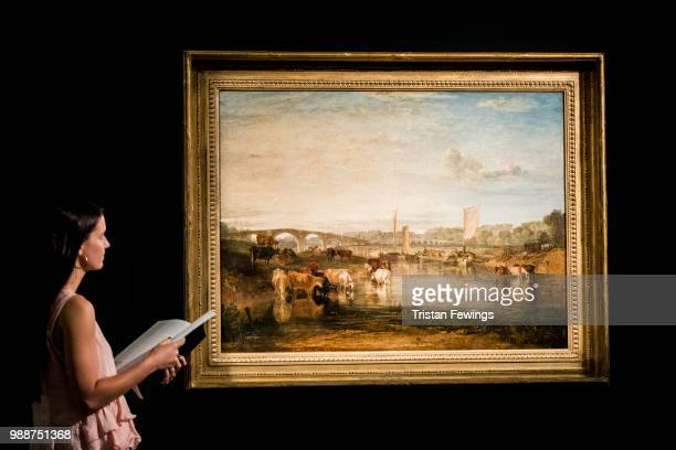 Cataloguer Arianna Leoni Sceti Walton viewing Bridges by JMW Turner goes on display as part of the Old Masters Exhibition at Sotheby's on June 29...