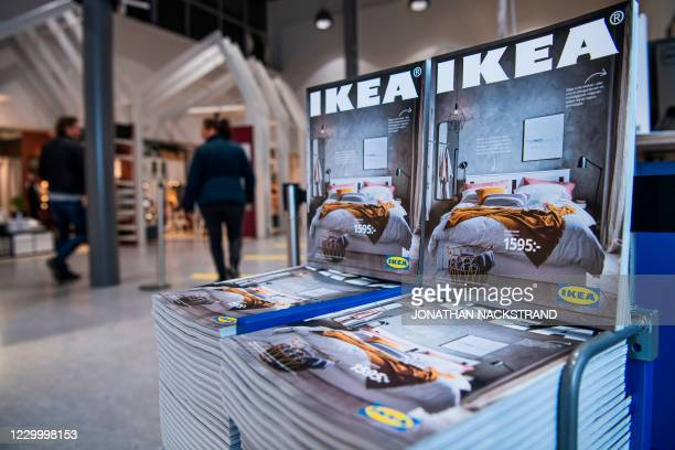 Catalogues are placed for people to take at the entrance to one of the stores of the Swedish furniture giant Ikea on December 7, 2020 in Jarfalla,...
