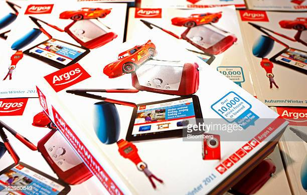 Catalogues sit on display at an Argos store operated by Home Retail Group Plc in Enfield UK on Wednesday Sept 7 2011 Home Retail Group Plc owner of...