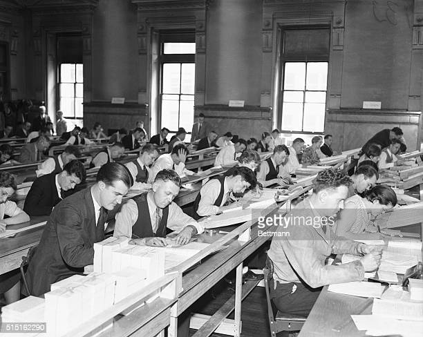 Cataloguing Pension Eligibles Some of the 2500 clerks who are working in the US Census Bureau office at St Louis Mo at the task of cataloguing in an...