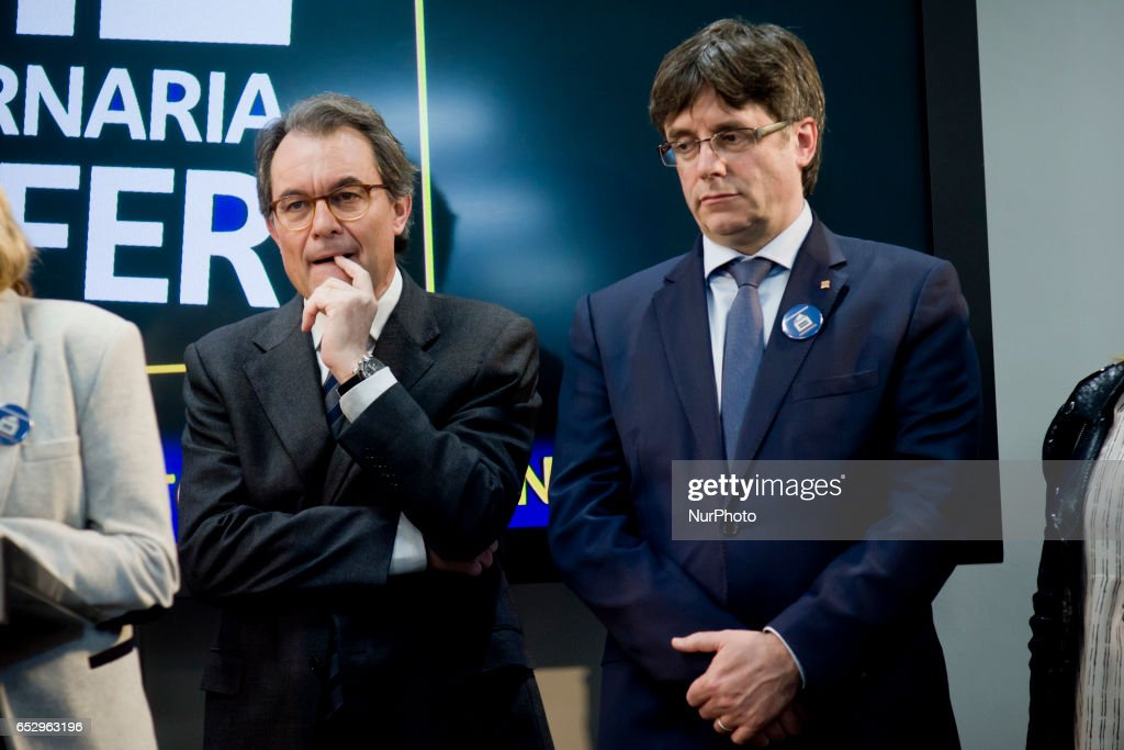 Catalonia regional president CARLES PUIGDEMONT (R) during a press conference in Barcelona, Spain on 13 March, 2017, close to former catalan President ARTUR MAS (L) after Spanish constitutional court announced barred him from holding public office. Artur Mas has been banned from holding public office for two years after being found guilty of disobeying the Spanish constitutional court by holding a symbolic independence referendum three years ago.