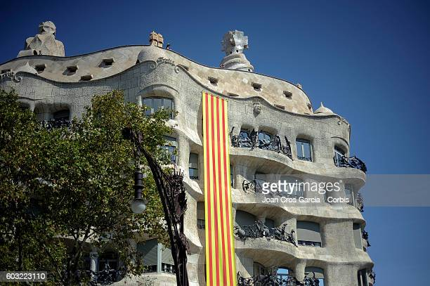 Catalonian flag is hung from La Pedrera designed by Antoni Gaudí showing a Catalonia's flag during the Catalonia National Day La Diada on September...