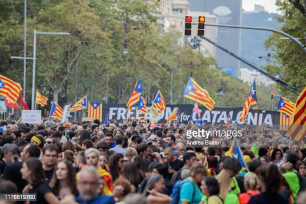 Catalonian independence supporters take part in a massive demonstration of over a million of people in the streets of Barcelona during a general...