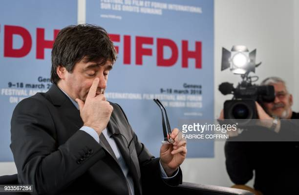 Catalonia's deposed leader Carles Puigdemont gestures during an interview on the sideline of the International film festival and forum of the human...