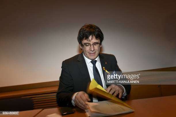 Catalonia's deposed leader Carles Puigdemont sits down for his briefing of the situation in Catalonia at the Finnish Parliament in Helsinki Finland...