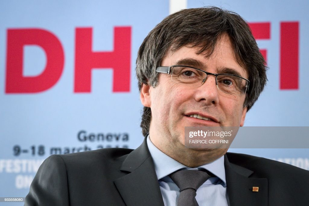 Catalonia's deposed leader Carles Puigdemont smiles during an interview on the sideline of the International film festival and forum of the human rights (FIFDH) on March 18, 2018 in Geneva. Puigdemont said in an interview published on March 18, 2018 that he should have declared independence earlier, as delaying the call in hopes of starting dialogue with Madrid proved futile. / AFP PHOTO / Fabrice COFFRINI