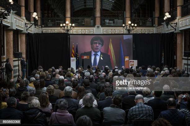 Catalonia's deposed president Carles Puigdemont address his audience via a live video feed from Brussels at a meeting of Junts Per Catalunya party...