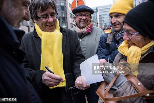 Catalonia's deposed regional president Carles Puigdemont attends a proindependence demonstration on December 7 2017 in Brussels A sea of around 45000...