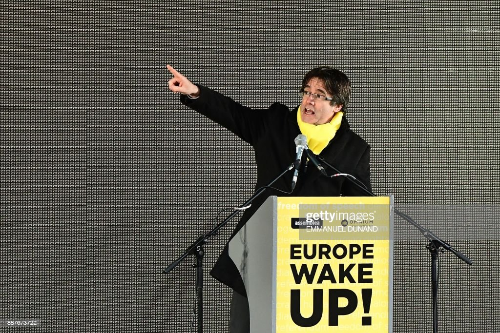 Catalonia's deposed regional president Carles Puigdemont gestures as he speaks during a pro-independence demonstration on December 7, 2017 in Brussels. A sea of around 45,000 pro-Catalonia protesters demonstrated in Brussels on December 7 to show support for the region's deposed president and urge the EU to support its drive for independence from Spain. /