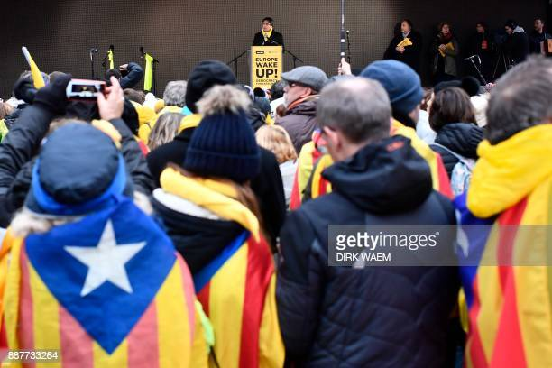 Catalonia's deposed regional president Carles Puigdemont speaks during a proindependence demonstration on December 7 2017 in Brussels A sea of around...