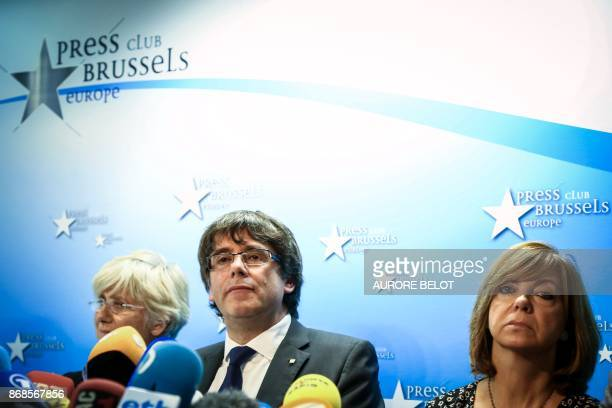 Catalonia's dismissed leader Carles Puigdemont along with other members of his dismissed government addresses a press conference at The Press Club in...