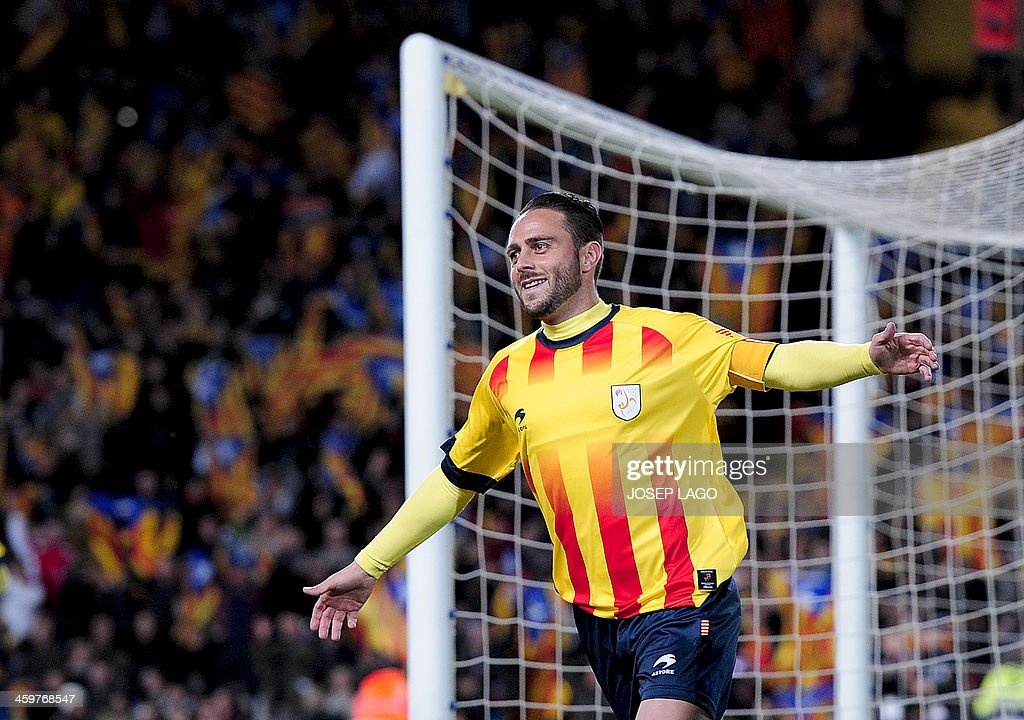 Catalonia's forward Sergio Garcia celebrates after scoring during the friendly football match Catalonia national team vs Cape Verde national team at Lluis Companys Olympic stadium in Barcelona on December 30, 2013.
