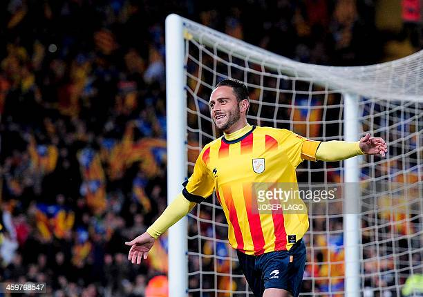Catalonia's forward Sergio Garcia celebrates after scoring during the friendly football match Catalonia national team vs Cape Verde national team at...