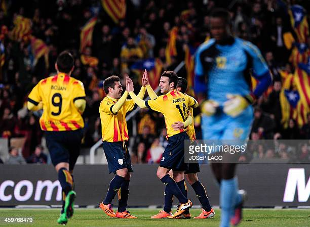 Catalonia's forward Sergio Garcia celebrates with his teammates after scoring during the friendly football match Catalonia national team vs Cape...