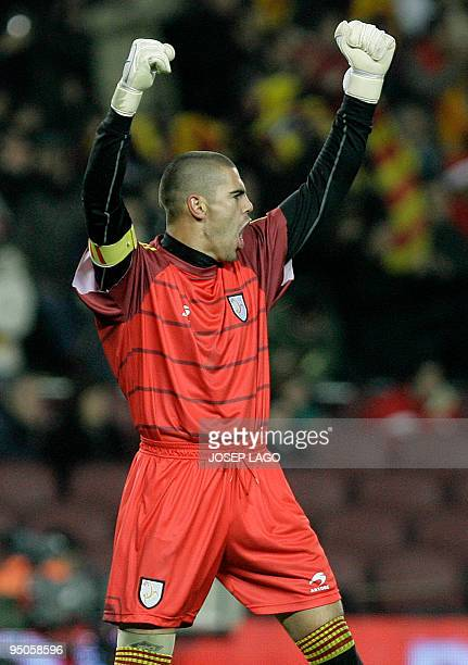 Catalonia's goalkeeper Victor Valdes reacts after his teammate Sergio Garcia scored during a friendly football match between Catalonia National Team...