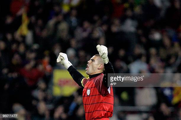 Catalonia's goalkeeper Victor Valdes reacts after the goal by his teammate Sergio Garcia during a friendly football match between Catalonia National...