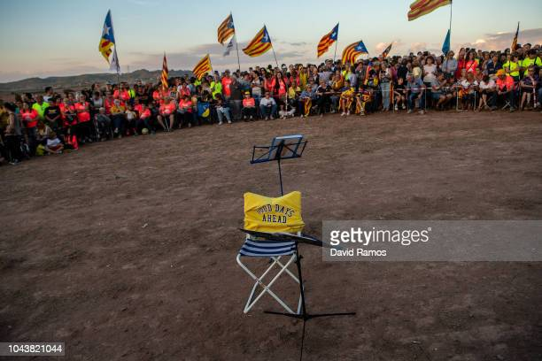 Catalonia's Independence supporters attend a concert as they gather on a field overlooking the prison of Lledoners on September 30 2018 in Sant Joan...