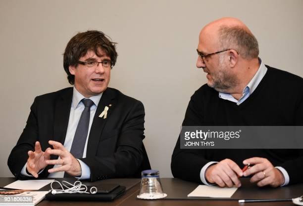 Catalonia's ousted regional president Carles Puigdemont and spokesperson of separatist party 'Junts per Catalonia' Eduard Pujol i Bonell speak...