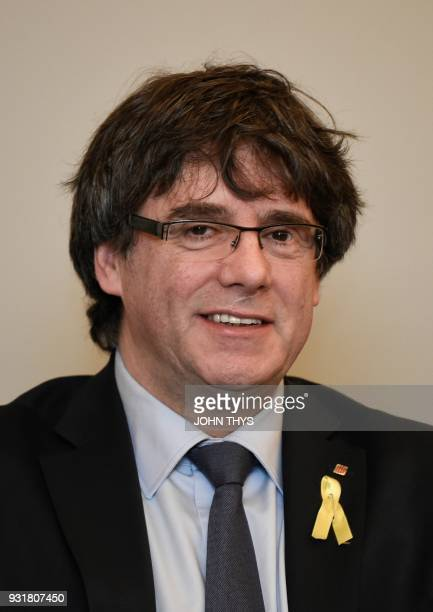 Catalonia's ousted regional president Carles Puigdemont takes part in a meeting of members of his parliamentary group in Brussels on March 14 2018 /...